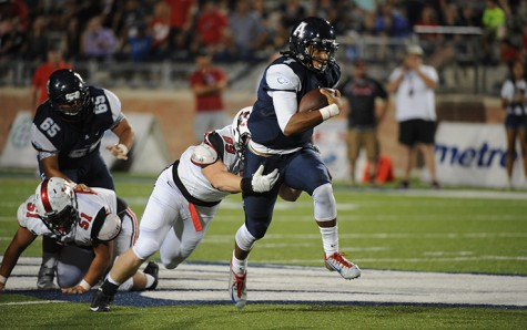 Quarterback Seth Green breaks a tackle on his way to the endzone