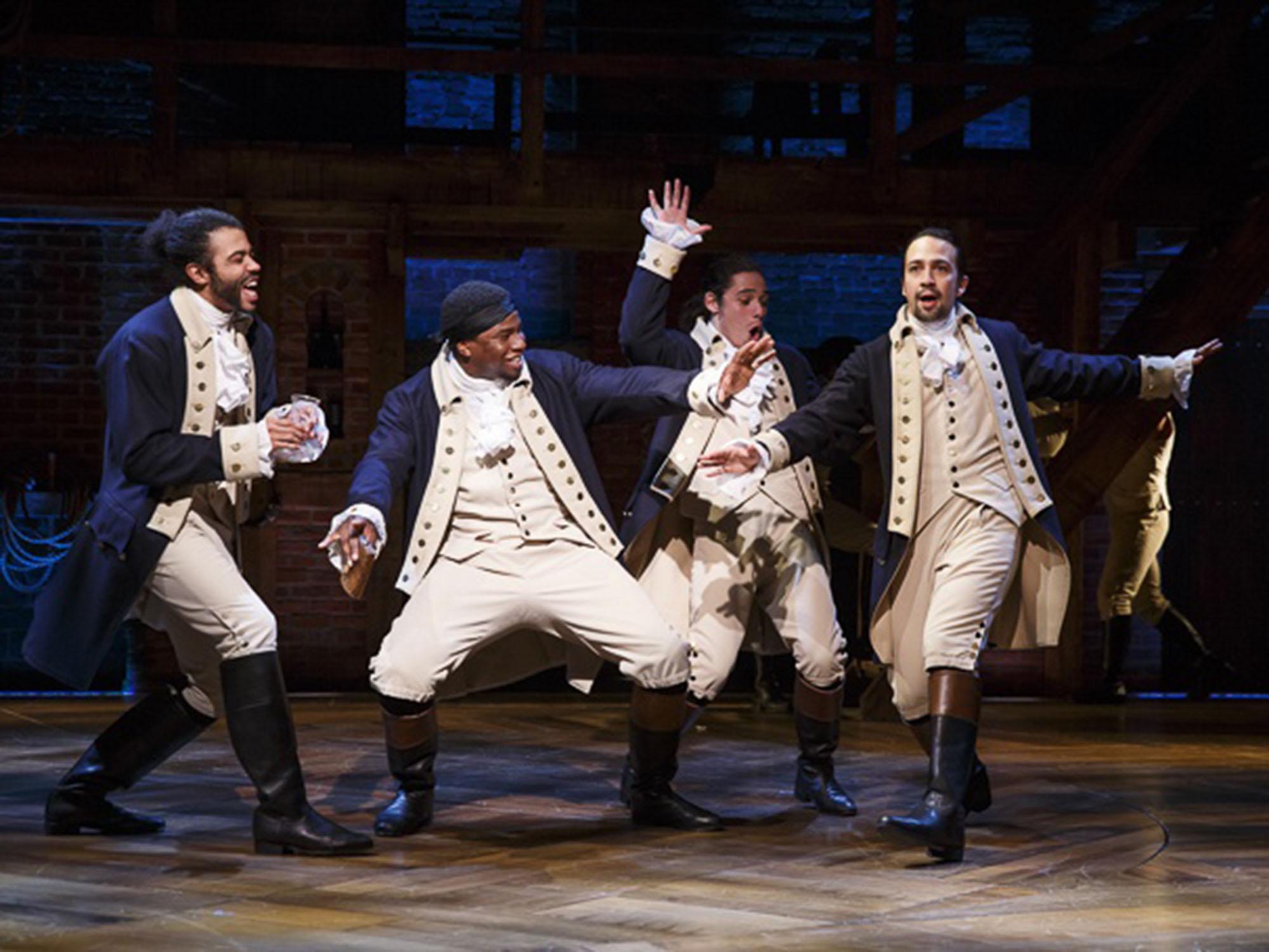 "Daveed Diggs as Marquis de Lafayette, Okieriete Onaodowan as Hercules Mulligan, Anthony Ramos as John Laurens and Lin-Manuel Miranda as Alexander Hamilton in ""Hamilton."" (Joan Marcus)"