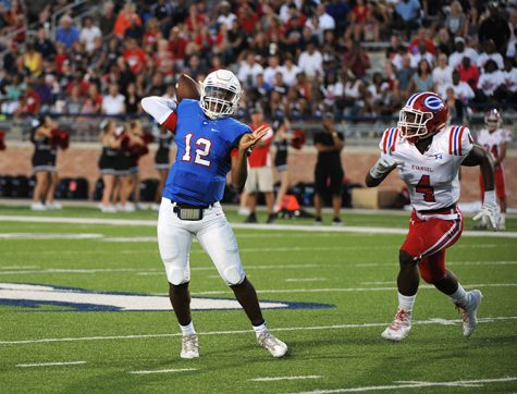 Sophmore QB Grant Tisdale scrambles to his right attempting a pass in the second quarter.