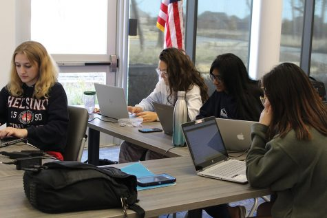 "All-girls computing team Charlie competes in the U.S. cyber patriot challenge on Nov. 17. ""Basically, this competition is about securing the computer to prevent hackers from breaking in,"" junior Rebecca Huang said. Charlie is one of the two all girls teams that composes the Allen cyber patriot."