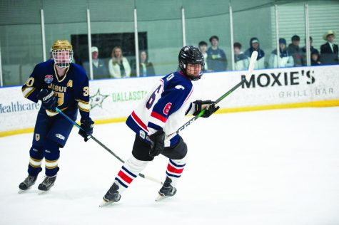 #6 Ethan Chen skates past Jesuit player #30 Luke Skaggs.