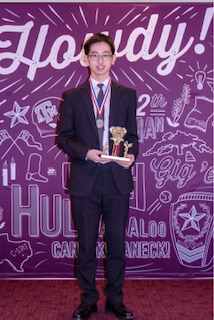 Ethan Zhou at the Texas Junior Science and Humanities Symposium  with his award.