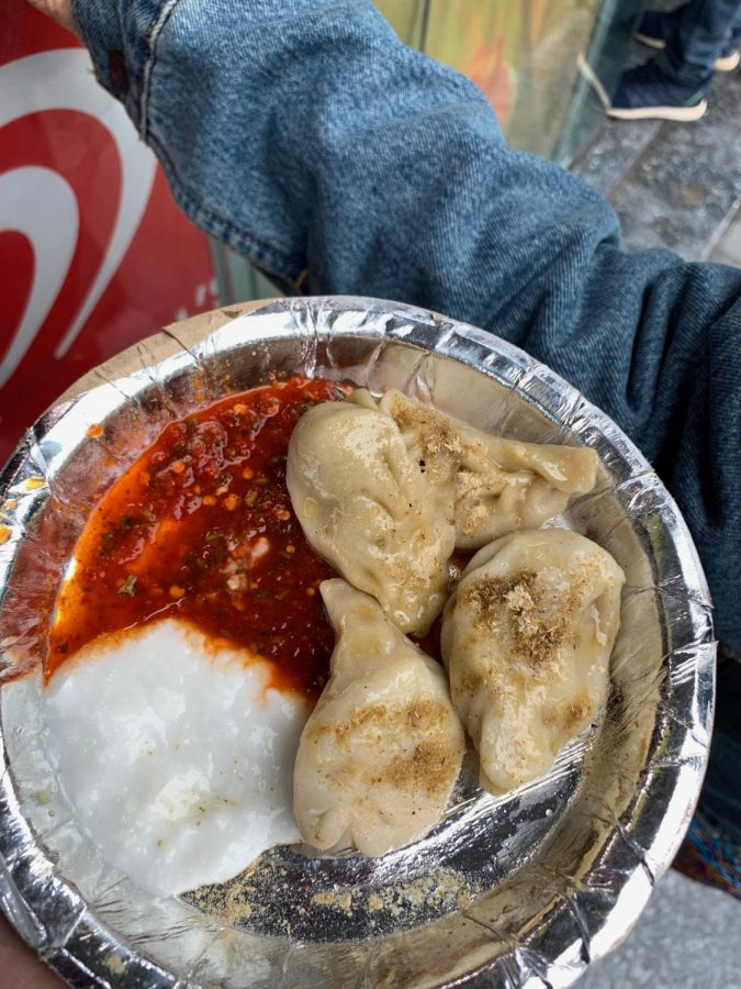 Non Veg momos on the streets of New Delhi. It is served with a chili sauce and yoghurt for the low price of 56 cents. *